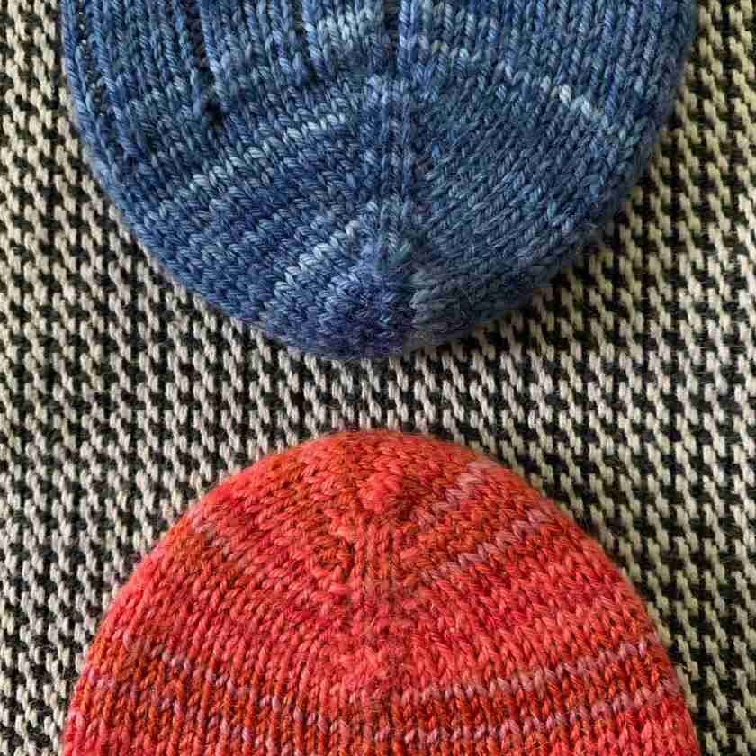 two hand knit sock toes