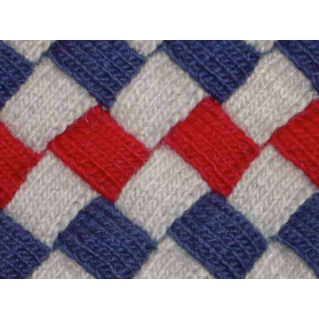 White, blue, and red knitted entrelac