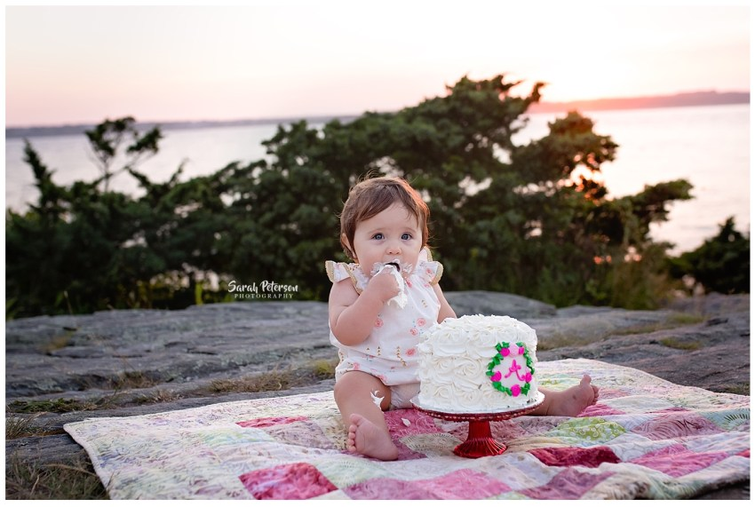 birthday girl eating her cake in the sunset