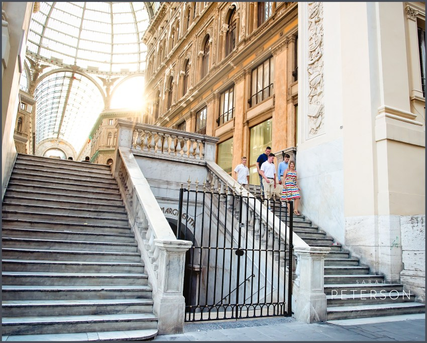 family walking down steps in Galleria Umberto Naples Italy