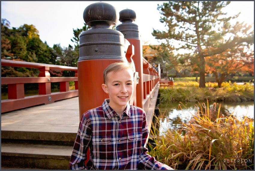teenage boy portrait with sunset behind in a Japanese garden