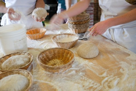 Preparing bread dough at Hungry Ghost Bread in Northampton.