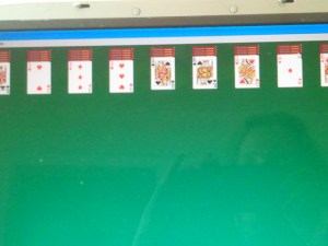 Playing Solitaire on it.
