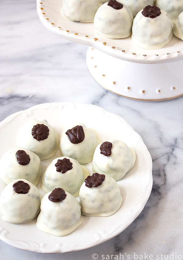 Tuxedo Oreo Truffles – your favorite Oreo Truffles, crushed Oreo cookies blended with cream cheese, decorated with black and white chocolate, and given a fun and fancy name.