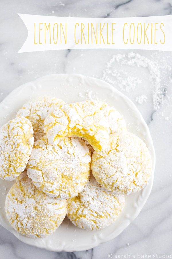 Lemon Crinkle Cookies – a delicious lemon cake mix cookie rolled in powdered sugar and baked to crinkle cookie perfection; a lemony summer delight.