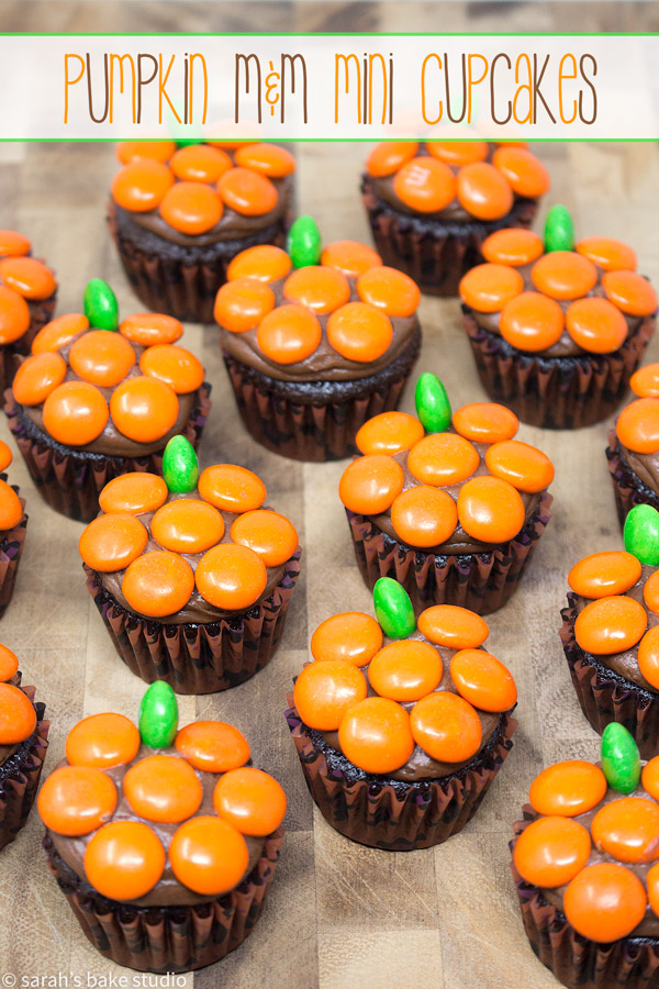 Pumpkin M&M Mini Cupcakes – chocolate mini cupcakes topped with chocolate buttercream and decked out with orange and green M&M's Milk Chocolate Candies to resemble pumpkins.