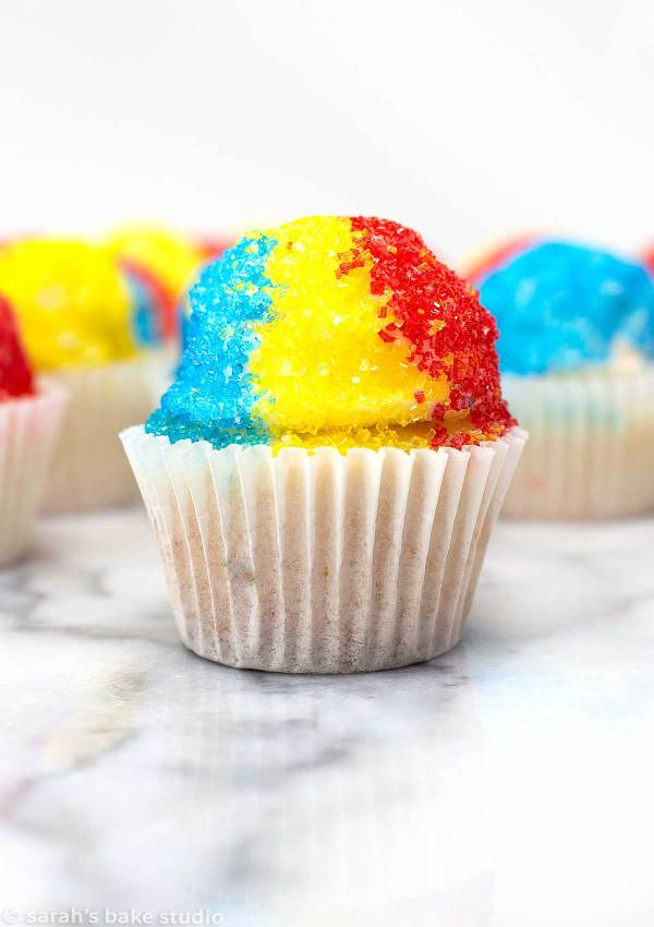 Snow Cone Mini Cupcakes - easy-breezy, delightfully cute mini cupcakes adorned with colorful sanding sugar to resemble delicious snow cones; a fun and delish way to celebrate summer with just one bite.