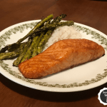 Salmon on a plate with asparagus and white rice