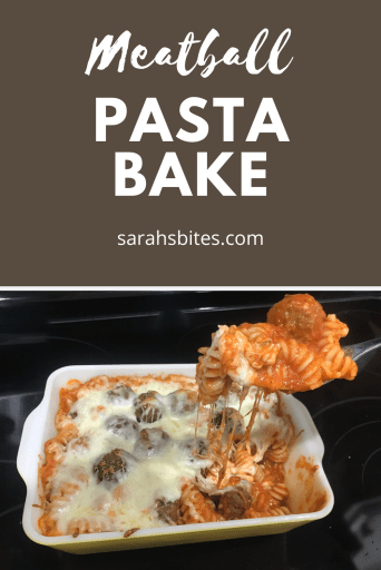 Pasta with cheese and meatballs being spooned out of a baking dish
