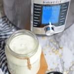 Yogurt in a jar next to an Instant Pot
