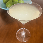 key lime pie martini with a bowl of limes in the background