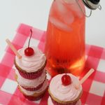 Cupcakes in front of a pitcher of Shirley Temple drink