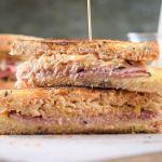 Reuben sandwich sliced in half.