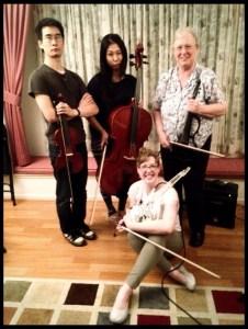 (l to r): Jonathan Sun (violin), Judy Kang (cello), Sarah Wallin Huff (electric 6-string violin), Kay Pech (electric 5-string violin).