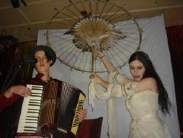Carolyn Ryder Cooley performs with Sarah Zar and her parasol
