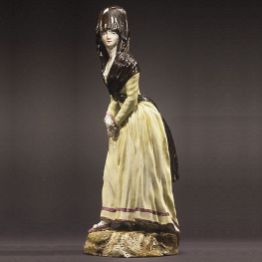 ceramic sculpture of an 18th century woman with a third eye.