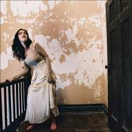 Photograph of artist Sarah Zar in a handmade layered lace gown