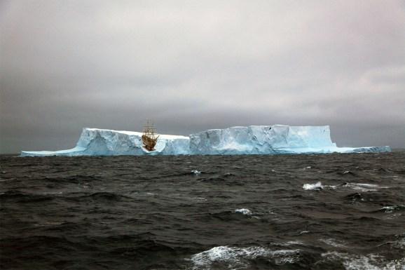 model ship stranded on melting iceberg