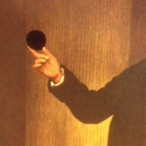 hand holding a black polka dot spot