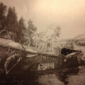 moonlight hunter from riddled with spots hunting on a lake while his friend paddles the canoe