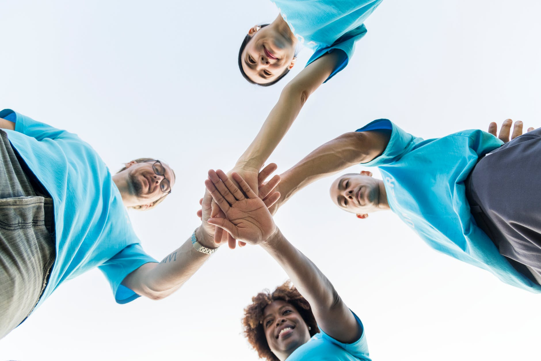 low angle view of people in wearing blue shirts