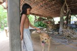 Visited a village family as part of our cooking class. Little girl and her dog.