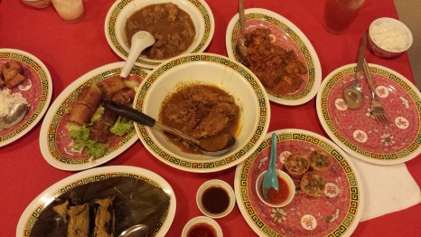 A Nonya feast. Clockwise from bottom left corner: Otak otak, Spring roll & Loh bak (tofu skin with pork), Pork stew hong bak, Ah char awak (pickled veggies with peanut sauce), Top hat with jiew hu char, Curry kapitan in the middle.