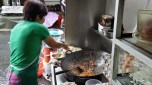 The woman making my char koay teow, her motions were too fast for my camera phone.