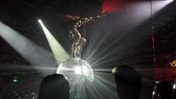 Russian acrobat balancing on a spinning giant disco ball! At Opera house cabaret.