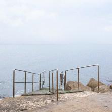 Ancona, luglio 2009. Scaletta sulla spiaggia cittadina del Passetto.