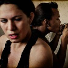 "San Pedro Sula, Honduras. May 2008. Deylin and Manuel ""la nelo"" at their hotel room smoking crack. Deylin Monserrat is a transsexual commercial sex worker. She is HIV positive and lives in a small and destroyed hotel where she works and lives together with Manuel. Manuel Martinez ""la negra"" is a transsexual commercial sex worker and he is HIV positive. They booth are addicted to crack, marihuana and alcohol."