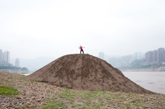 A boy is playing on the river basin; throwing rocks in the Yangtze; Chongqing