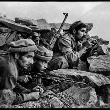 "AFGHN-10260, Nuristan, Afghanistan, 1979. CAPTION: Mujahideen Watch a Russian Convoy. Nuristan, Afghanistan,1979. Mujahideen fighters watch convoy, 1979""After this photograph was published in The New York Times (in a vertical format), McCurry's career took off. Its publication identified McCurry as a photographer with inside knowledge and contacts as the conflict between the Soviet Union and Afghan nationals expanded. The image also heralded the photographer's intense, poetic approach to telling stories with an economy of means, strategically employing composition, light, and space as narrative tools. Here, for instance, the story is more powerfully told without seeing the Russian convoy the Mujahadeen fighters are so intensely observing, leaving the threat of their presence in mist outside the frame."" - Phaidon 55 Mujahideen observe a Russian convoy, Nuristan, Afghanistan, 1979. Pg 16,17, Untold: The Stories Behind the Photographs Magnum Photos, NYC21021, MCS1980002 W00052/00A Steve Mccurry_Book Untold_Book final print_Beetles and Huxley MAX PRINT SIZE: 40X60 retouched_Sonny Fabbri 10/13/2015"