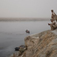 Iraqi army soldiers controls the security for the people who cross the Tigris river by small boats, who escape from the fight between Iraqi army and Islamic State militants near Tuebe village, southeast of Mosul, IRAQ November 2016 According to the UN last report (4th november) more than 40 thousand people displaced in since the begining of operations.