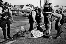 A demonstrator is arrested by St. Louis police on West Florissant Avenue in Ferguson, Missouri while protesting the killing of Michael Brown, an unarmed 18-year-old African-American teenager who was shot and killed on August 9, 2014 by Darren Wilson, a white police officer, in Ferguson, Missouri - a predominantly black suburb of St. Louis whose police force is 94 percent white. Brown's death and a heavily militarized police response to protests sparked months of demonstrations throughout the St. Louis area. Tuesday, August 19, 2014.