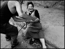 GEORGIA. Outskirts of Gori. August, 2008. Woman desperate and fainting.
