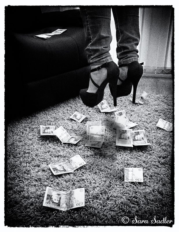 lady in high heels floating above some money