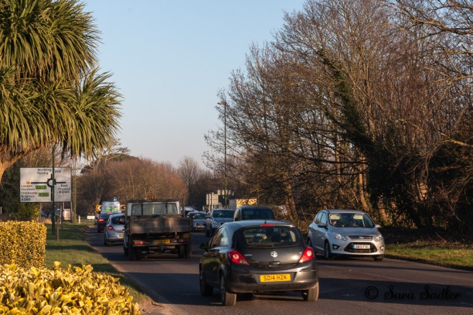 busy single carriageway prior to trees being cut down