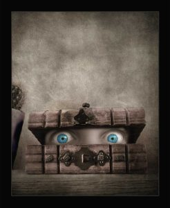A new updated version of lockdown art featuring eyes looking out of a box appears in Museum exhibition and Founders cup award finalist