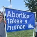"Joe Biden's Jaw Dropped When He Saw a Banner Saying ""Abortion Takes a Human Life"""
