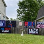 """Woman Fined for """"F— Biden"""" and """"Joe Biden Sucks"""" Signs in Her Yard Refuses to Remove Them"""