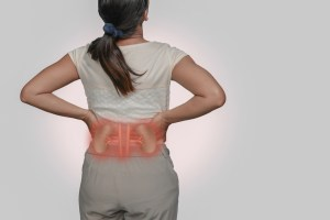 woman suffering from kidney infection symptoms