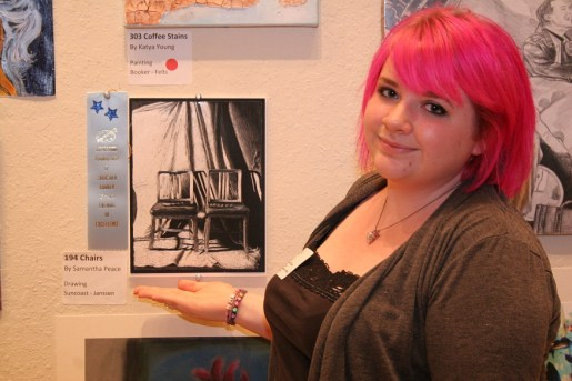 Suncoast Polytech's Samantha Peace with her drawing, Chairs.