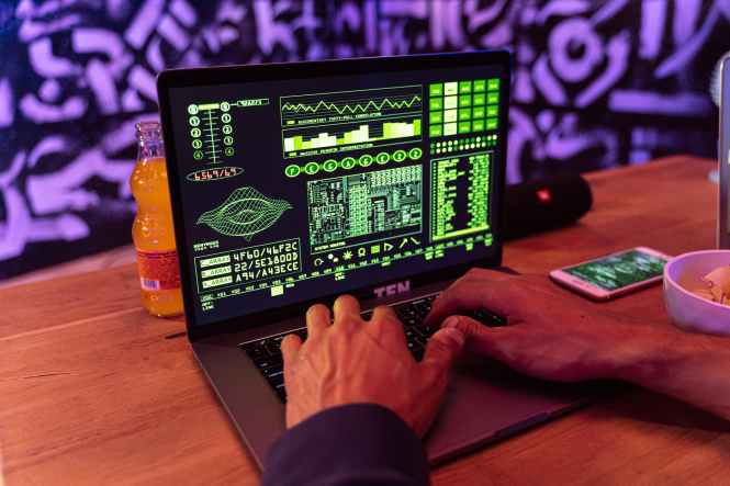 person playing game on black laptop computer