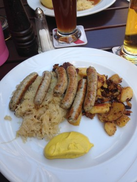 Sausages, sauerkraut, and potato hash.