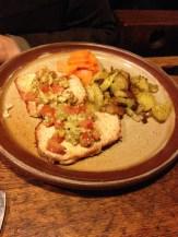 Pork schnitzel with a garlic sauce.