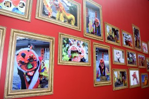 Pictures of lion dance costumes inside the photo gallery at Times Square.