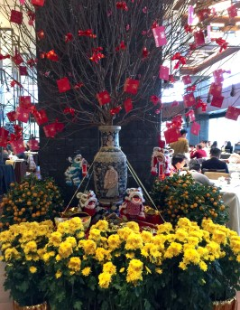 Chinese New Year tree decorated with red pockets at a restaurant in Renaissance Hotel.