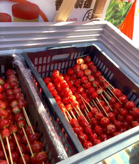 Strawberries filled with honey syrup in the style of traditional Chinese candy sticks.