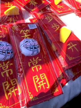 Soft-textured Chinese couplets, wishing others a life of wide smiles and happiness.